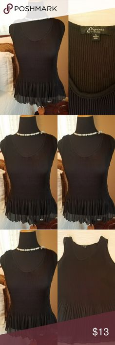 Elegance Top Elegance pleated top,flares at bottom. 95% polyester, 5% spandex. Good used conditiom. Elegance Tops Tank Tops
