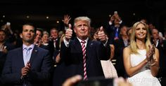 Republican presidential candidate Donald Trump gives two thumbs up, as his son Eric Trump delivers a speech during the third day of the Republican National Convention on July 20, 2016 at the Quicken Loans Arena in Cleveland, Ohio. Donald Trump received the number of votes needed to secure the party's nomination.  #2016InFocus