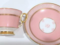 Golden rings of love dance around the edges of this detailed tea cup and saucer.  This luxurious set is by Royal Adderley Fine Bone China of Lawley, England. Measurements: The saucer is 5.5 in diameter. The cup is 2.75 high and 3.5 from rim to rim. This English tea set is in excellent condition. Although we wish to sell this set, we prefer to have loyal repeat customers. You may buy with confidence. We do not sell damaged items and we note any flaws that we see.  To receive our listings as…