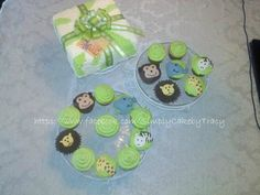 """Simply Cake by Tracy...Baby Shower - Zoo Animals Cupcakes and """"Gift"""" Cake. All vanilla decorator buttercream icing. 9in double layer cake (serves approx 20ppl) and 18 coordinating animal cupcakes."""