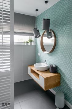 Blue-Green feature tiles give this bathroom a soft and fresh feel.