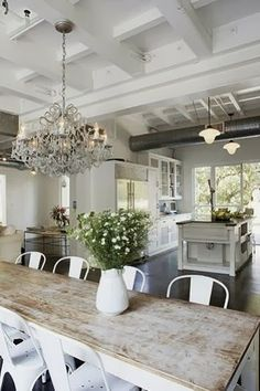chandelier + farmhouse table + rustic