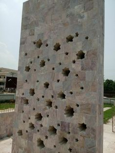 Back of the main monument. Rugged holes indicating the exit wounds from the projectile (bullets). Nice aesthetics in construction by the engineer battalion. 35 FF Monument at Jarpal.