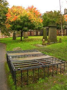 These Mortsafes in Greyfriars Cemetery, Edinburgh, Scotland were used to protect the dead from body snatchers, a practice in the 19th century to provide anatomy schools with fresh bodies. See the famous Burke and Hare case