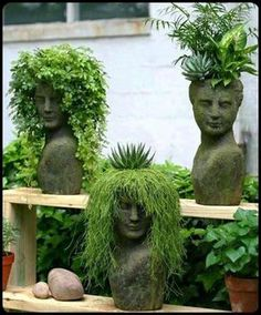 These Are Awesome - plants & succulents growing in statues. #garden #plants ✿