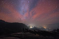 Long after sunset on January 25 an unusually intense red airglow floods this south-looking skyscape. The scene was recorded with a long exposure using a digital camera over Yunnan Province in southwest China. At best faintly visible to the eye, the lingering airglow is due to chemiluminescence, the production of light through chemical excitation.