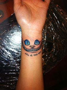 30 Alice in Wonderland Tattoo designs with meaning! Cheshire Cat Tattoo, Chesire Cat, Body Art Tattoos, New Tattoos, Girl Tattoos, Tatoos, Tattoo Ink, Wrist Tattoos For Women, Small Wrist Tattoos