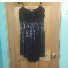 Black and silver leopard dress Spaghetti strap sweetheart neck dress. I have worn with the straps on and also tucked in as a strapless. The top has tiny silver specks. The bottom is silver metallic and black leopard print. Very form flattering. Bought at Macy's. Dresses