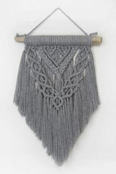One-of-a-kind hand knotted macrame wall hanging. Made with grey cotton string on found driftwood. Driftwood width: 10.5 inchesLength from driftwood to bottom: 15 inchesLength from nail to bottom: 19 inches