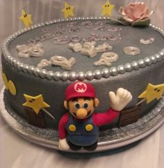 Mario cake SuperMario whatch at: https://www.facebook.com/pages/Mycake/518427724909847