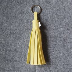 A modern luxury keying with metal fob made from 100% wool felt.