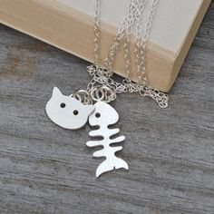 "An unusual handmade fishbone and cat necklace.You can choose from either pendant or both pendants on your chain. Length of the sterling silver chain: 16"" (40cm), 18"" (45cm) or 20"" (50cm).This cute necklace is for cat lovers everywhere, two pendants adorn the sterling silver chain both the happy, satisfied cat pendant with the remains of his lunch, a fish bone pendant. This unusual necklace is hand-sawn from a sheet of sterling silver using the traditional method which has been used to make…"