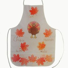 The kids will love helping you create this keepsake apron to wear when you serve Thanksgiving dinner ... Or think one-of-a-kind hostess gift! All you need is a light-colored cotton-blend apron and unique new Ink Effects transfer paint.