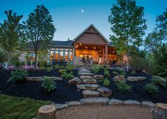Homearama 2014 - Wieland Builders - This beautiful outdoor space includes truncated log seating and a fire put in its design. Interested in a custom home? Cindie Richie can help. http://www.comey.com/re/roster/agentprofile/agent/CynthiaWRichie