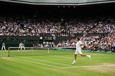 Roger Federer and Novak Djokovic play eachother on Centre Court during the semi-finals. - Tom Lovelock/AELTC