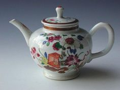 Famille rose globular teapot and cover decorated with a vase of flowers and floral sprays. Qianlong period circa 1760