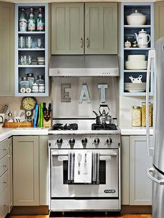 Optical Illusions- Removing select cabinet doors and painting the boxes light blue also helps the space feel open and airy. Over the range, a stainless-steel backsplash and large zinc letters add character.