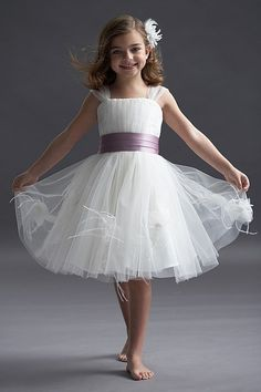 This is super cute and age appropriate. I can't stand when they put strapless dresses n the flower girl!
