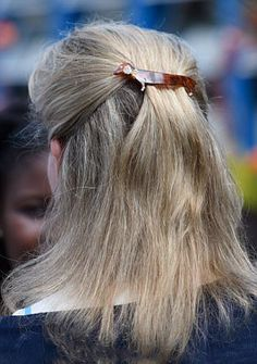 Sophie, Countess of Wessex, wore her blonde hair loosely clipped back, a cute sausage dog clip with diamante studs holds her long her back.
