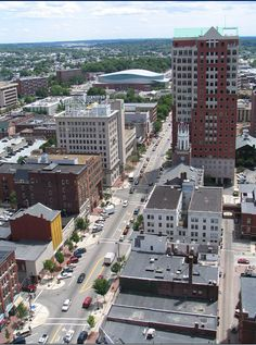 """Photo showing the view of Elm Street in Manchester, New Hampshire, looking south. Source: Wikimedia Commons. Read more on the GenealogyBank blog: """"How to Standardize Your Geographic Locations."""" http://blog.genealogybank.com/how-to-standardize-your-geographic-locations.html"""