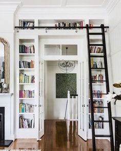 Calling all bookworms! Reading nook. Bookshelves around door with ladder. { via @suzannechildress}