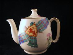 small Scottish souvenir teapot ... decorated with thistle and tartan (plaid) sash pinned with Scotland's lion symbol, gold edging on rim, handle and lid, ceramic, UK