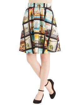 Around the World in Katie Days Skirt. For the media maven whose style is as vibrant as her stories, sporting this pocketed skirt is a no-brainer! #multi #modcloth