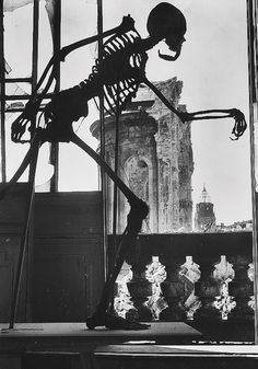 A class skeleton stands damaged in the bombed ruins of Dresden, 1945. Richard Peter