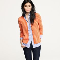 Orange looks good weekly, and so does she! love the Blue jeans. She looks like a busy Gator Fan.