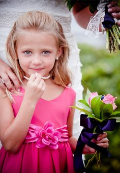 Pink dress and a simple strand of pearls for your flower girl. Julie Dreelin's Beach Productions http://www.outerbanksweddingassoc.org/membersearch/memberpage.html?MID=1872=Videographers=21 #pink #pearls #flowergirl #obxwedding