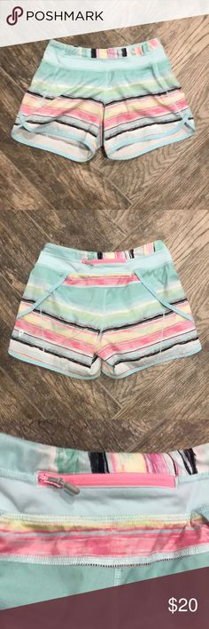 Ivivva Striped Gym Shorts Girls Ivivva Striped Gym Shorts, size 14.  They have built in undies, a pocket in the top seam and 1 zipper pocket on the back.   Pre-owned: excellent condition! Ivivva Bottoms Shorts