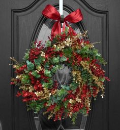 Christmas Holiday Wreath made from red, green and gold glittery eucalyptus.  Can be used for front door decoration, home décor, and to decorate your outside house lights!  Everything is customizable.