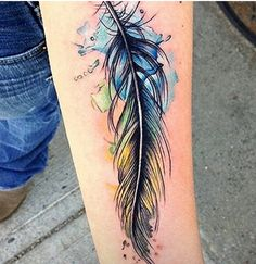 Watercolor tattoo feather