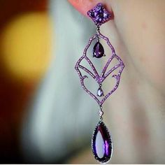 Possibly one of the most perfectly balanced and intriguing piece of #jewelry ever made. Royal in purple #amethysts and red #rubies. By the talented and unique @dioneaorcini. #globalnomad Amethyst and rubies earrings by #dioneaorcinifinejewelry #Amethyst was considered a symbol of royalty. Repost from @plukka
