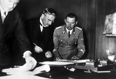 British Prime Minister Neville Chamberlain signing the Munich Treaty with Nazi Germany, 1938
