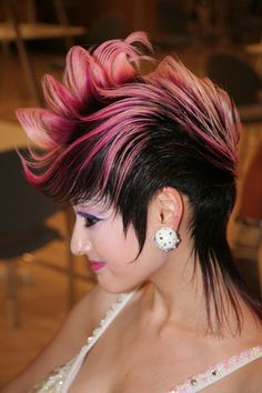 Dark crop haircut with long wispy sides and back and pink and blonde dip dyed mohawk styled ends hairstyle