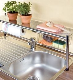 Get an over-the-sink shelf to double-up on counter space. apartment decorating 17 Ways To Squeeze A Little Extra Storage Out Of A Tiny Kitchen Ideas Para Organizar, Small Space Living, Tiny Living, Home Organization, Organizing Life, Organizing Ideas, Home Kitchens, Counter Space, Extra Storage