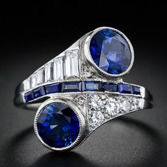 Bypass rings are a personal favorite, and I love the bold pair of deep blue sapphires (4 carats together!) that anchor this one. That one side of the calibre-cut sapphire line between them has simple baguettes and the other round diamonds adds a lot of interest, too. Art Deco, platinum.