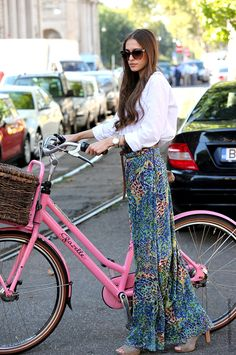 How does she cycle in that skirt?
