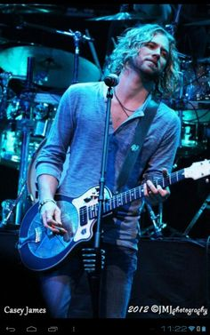 Casey James. Don't know him but he's gorgeous, has great hair and plays the guitar. What else could you want.