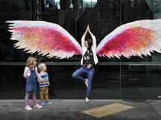 Image result for photographed with angel wing graffiti