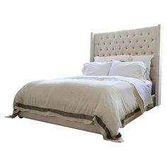 Transform the master suite or guest room into a sophisticated retreat with this chic bed, featuring button-tufted upholstery in a sand hue. ...