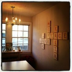 Scrabble wall tiles. Easy DIY project. Love this idea for a family den/movie/game room!