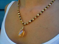 Tiger Eye semiprecious stones,mother of Pearl necklace with hand wrapped Gold Aura Crystal Quartz pendant. Quartz Crystal Necklace, Gemstone Necklace, Beaded Necklace, Necklaces, Pendant Necklace, Mother Of Pearl Necklace, Crystals And Gemstones, Beading, Jewelry Making