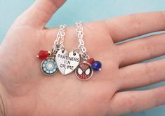 "If you love Tony Stark and his new ""adopted"" son and/or protégé Peter Parker, you'll love this necklace set! Dedicated to Spider Man and Iron Man, this Marvel friendship necklace set is perfect for you and your best friend. First Iron Man, Bff Necklaces, Iron Spider, Friendship Necklaces, Marvel Comics, Marvel Art, Marvel Memes, Marvel Avengers, Avengers Symbols"