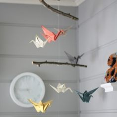 A sweet homemade origami bird mobile perfectly compliments this gender neutral nursery.