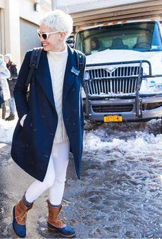 Laurel Pantin in her Tibi winter whites and navy blue tailored coat.