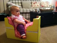 Spica cast chair. We used a box from Aldi, cut out the sides and put two pillows inside. This worked perfectly for her to watch movies or play sitting up!