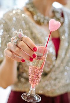 glitter champagne flute and pink heart stirrer