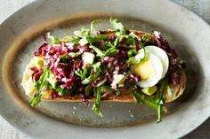 Bagna Cauda toasts with radicchio, garlic lemon anchovy dressing, celery, and avocado (skip boiled egg). Unlike the directions, layer the avocado on before the dressed radicchio celery mix. This will keep the presentation pretty!